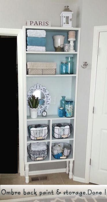 Front view of how it nicely fills the space and gives tons of storage in baskets, jars & shelves